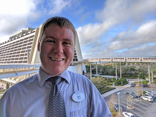 Photo of Ben Waychoff standing in front of the monorail train site at Disneyland