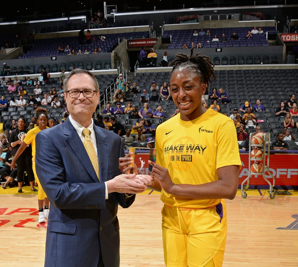 Todd DeMoss present an award to a WNBA Player.