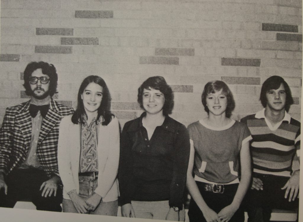 Five students from 1975 posing for a photo in the hallway at Prairie High School.